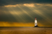 Sun Rays Photo Framed Prints - The Lighthouse As The Storm Breaks Framed Print by Meirion Matthias
