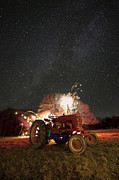 Night Time Photography Framed Prints - The Little Red Tractor that Could Framed Print by Keith Kapple