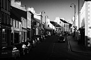 Ballycastle Photos - the main through road in Ballycastle Ann Street county antrim northern ireland by Joe Fox