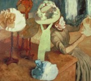 Sitting  Pastels Posters - The Millinery Shop Poster by Edgar Degas