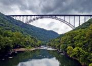 Cloudy Photo Prints - The New River Gorge Bridge in West Virginia Print by Brendan Reals