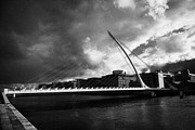 Economy Framed Prints - the new Samuel Beckett Bridge across the river liffey in Dublin republic of ireland under dark grey  Framed Print by Joe Fox
