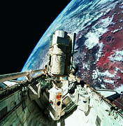 Space Shuttle Photo Prints - The Open Cargo Bay Of The Space Shuttle Orbiting Above Earth Print by Stockbyte