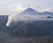 The Peak Of Semaru Rises Above Mount Print by Carsten Peter