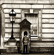 Buckingham Palace Photos - The Queens Guard by John Rizzuto