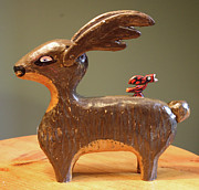 Folk  Sculptures - The Reindeer and the Cardinal by James Neill