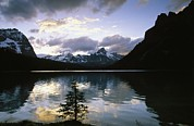 Mountains And Lake Prints - The Rocky Mountains Are Reflected Print by Michael Melford