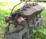 Iron  Sculptures - The Rollee Pollee by Larry Vennard