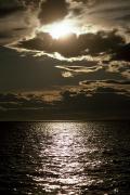 The Setting Sun Pierces A Menacing Print by Jason Edwards