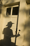 Doorbell Posters - The Shadow Of A Cowboy Appears To Ring Poster by Joel Sartore