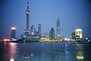Skylines Metal Prints - The Shanghai Skyline And Riverfront Metal Print by Raul Touzon