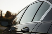 Car Window Framed Prints - The Side Panel Of A Black Car Framed Print by Roberto Westbrook