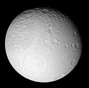 Impact Art - The South Pole Of Saturns Moon Tethys by Stocktrek Images