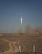 Rocket Boosters Prints - The Soyuz Tma-16 Launches Print by Stocktrek Images