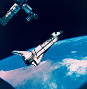 Space Shuttle Posters - The Space Shuttle And Space Station In Orbit Above The Earth Poster by Stockbyte