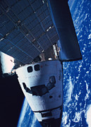Space Shuttle Photo Prints - The Space Shuttle Docked With A Space Station Print by Stockbyte