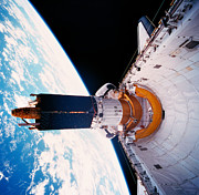 Space Shuttle Photo Prints - The Space Shuttle In Orbit With Its Cargo Bay Open Print by Stockbyte