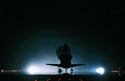 Runway Framed Prints - The Space Shuttle Landing With Its Drogue Parachute Deployed Framed Print by Stockbyte
