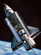 Space Shuttle Framed Prints - The Space Shuttle With Cargo Bay Open Orbiting Above Earth Framed Print by Stockbyte