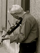 Buskers Photos - The Street Violinist by Jennifer Sabir