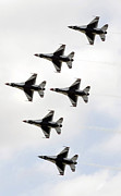 Jet Trails Posters - The Thunderbirds Form A 6-ship Delta Poster by Stocktrek Images
