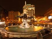 Bernini Photos - The Triton Fountain at Night by George Oze