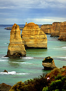 Australia Photographs Photos - The Twelve Apostles by Tam Graff
