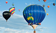 Balloon Fiesta Framed Prints - The World Aloft Framed Print by Jim Chamberlain