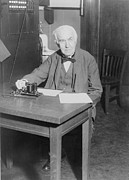 Edison Posters - Thomas Edison, Seated At Desk Poster by Everett