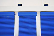 Repetition Photos - Three blue closed shutters by Sami Sarkis