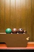 Wood Grain Prints - Three Bowling Balls In Bowling Alley Print by Benne Ochs