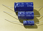 Electrolytic Photos - Three Electrolytic Capacitors by Andrew Lambert Photography