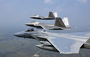 Flight Formation Photos - Three Fa-22 Raptors Fly In Formation by Stocktrek Images