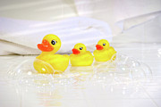 Bathing Photo Posters - Three little rubber ducks Poster by Sandra Cunningham