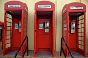 Telephones Prints - Three old-fashioned public telephone boxes in Gibraltar Print by Sami Sarkis