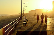 Casual Clothing Posters - Three People Walking Down Boardwalk Poster by Copyright Eric Reichbaum