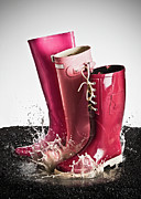 Puddle Posters - Three Pink Rubber Boots Splashing In A Puddle Poster by Larry Washburn
