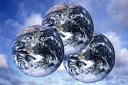 Consumption Prints - Three Planet Earths, Conceptual Image Print by Victor De Schwanberg