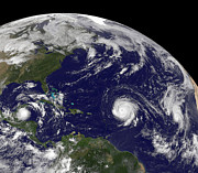 Natural Disasters Art - Three Tropical Cyclones Active by Stocktrek Images