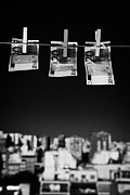 Three Twenty Euro Banknotes Hanging On A Washing Line With Blue Sky Over City Skyline Print by Joe Fox