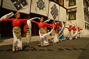 City Streets Prints - Tibetan Dancers Perform At The Chinese Print by Richard Nowitz