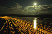 Myanmar Prints - Time Lapse Of Lights From Boats Moving Print by Steve Winter