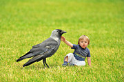 Lifestyle Digital Art Prints - Tiny boy playing with a crow Print by Jaroslaw Grudzinski
