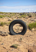 Scrub Brush Framed Prints - Tire In The Desert Framed Print by Paul Edmondson