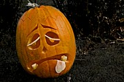 Carved Pumpkin Prints - Tired Pumpkin Print by Odd Jeppesen
