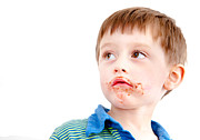 Toddler Eating Chocolate Print by Tom Gowanlock