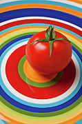 Plates Framed Prints - Tomato on plate with circles Framed Print by Garry Gay