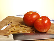 Vegetarian Posters - Tomatoes pasta and knife Poster by Blink Images