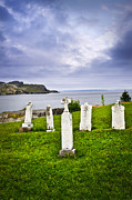 Headstones Posters - Tombstones near Atlantic coast in Newfoundland Poster by Elena Elisseeva