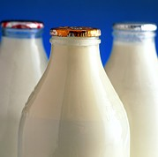 Bottled Photo Prints - Tops Of Three Types Of Bottled Milk Print by Steve Horrell